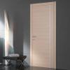 porta in legno rovere sbiancato con inserimento del listello in alluminio a richiesta e telaio inverso battente modello lt dorica castelli