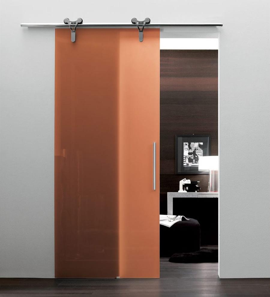 in vetro arancione trasparente logika scorrevole con binario a parete