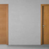 porta in legno faggio naturale semievaporato con intagli di essenze a contrasto in rovere tinto miele battente modello lt dorica castelli