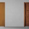 porta in legno rovere tinto miele con giochi di essenza a contrasto in noce nazionale bicolore battente modello lt dorica castelli