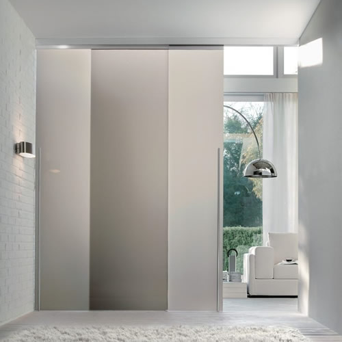 Porta in vetro acidato scorrevole light esterno muro con - Porte scorrevoli vetro esterno muro ...